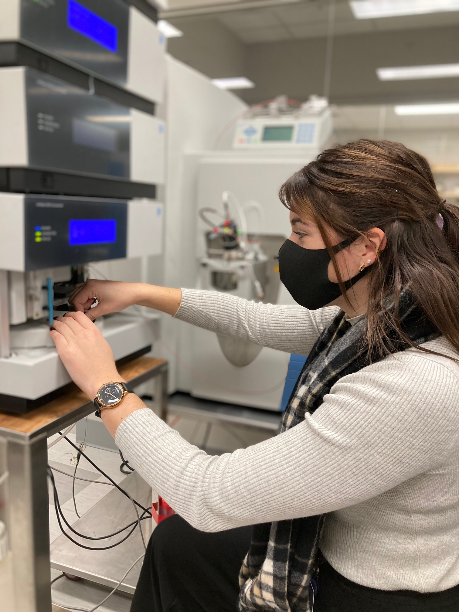 woman working on spectrometer
